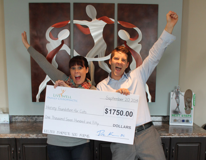 Dr. Jennie and Dr. Kris with the $1750 cheque that we raised for the Hervey Cat Foundation