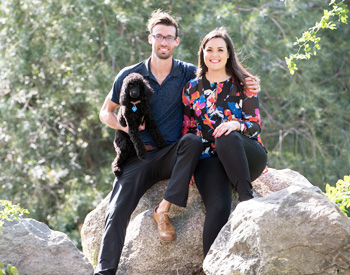 Dr. Jessica, her husband and their dog out on a hike