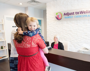 Woman and child being welcomed into Adjust To Wellness Family Chiropractic