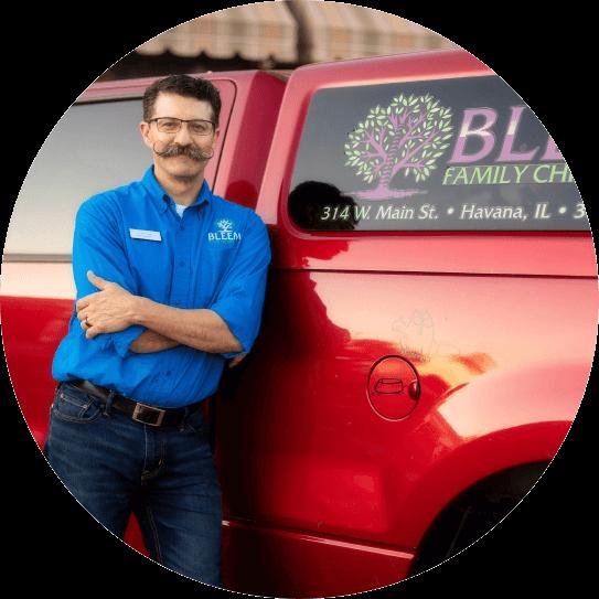 Dr Bleem leaning against truck