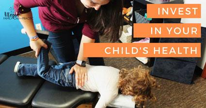 Dr. Lindsey adjusting child