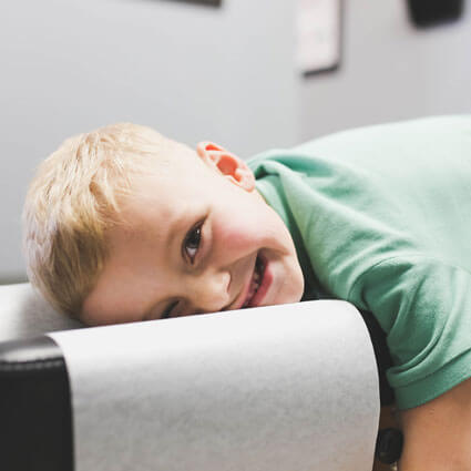 Happy kid laying on table