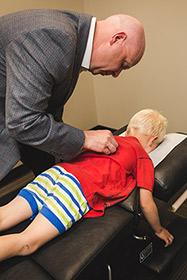 Dr. Pawlovich adjusting a child patient