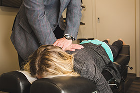 Dr. Pawlovich adjusting a patient