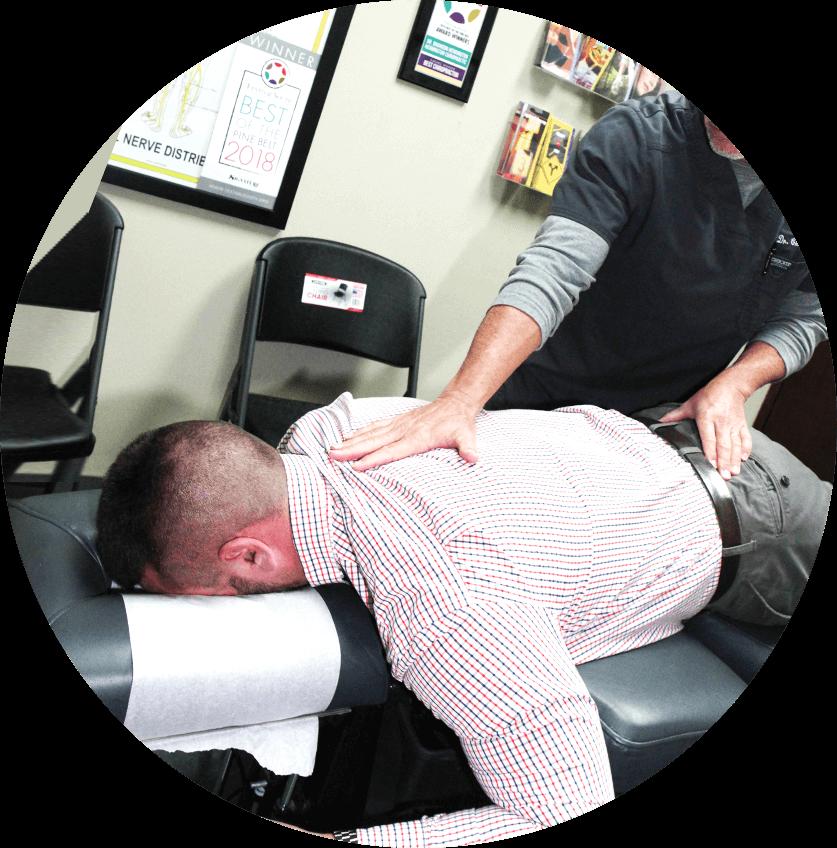 Dr. West adjusting male patient