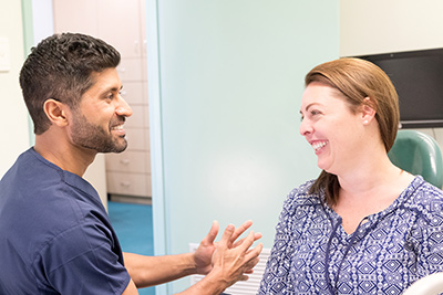 Dr Chopra conversing with patient
