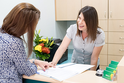 Patient being greeted at front desk