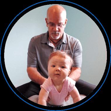 Dr Tosch adjusting young infant