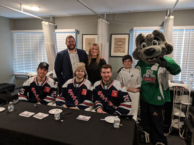 Doc with the Wolf Pack players