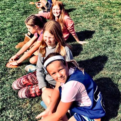 School kids sitting on the grass
