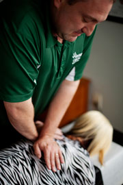 Lincoln Chiropractor Dr. Sjohn Watson gently adjusts a patient
