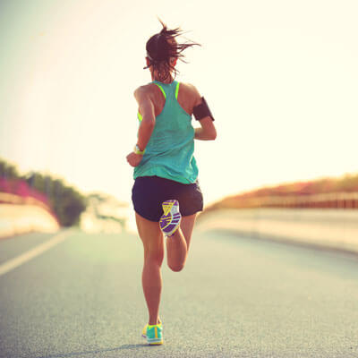 athletic woman running on a road