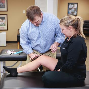 Dr. Dan taping patients knee