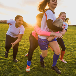 Young girls playing rugby