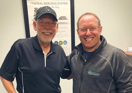 Dr. Pat with patient smiling