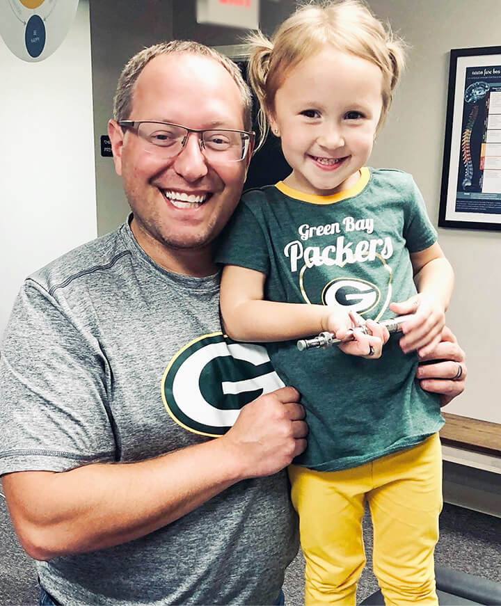 Dr Pat and little girl smiling