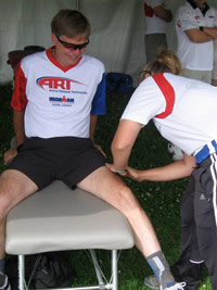 Dr. Paige working on Dr. Leahy, founder of ART at the Lake Placid Ironman.