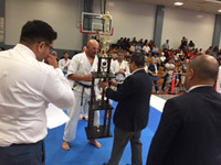 Man receiving trophy at competition