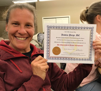 Dr Paige with certificate