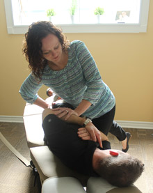 Dr. Cordick giving a chiropractic adjustment.
