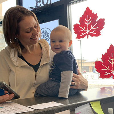 Woman and child at reception desk