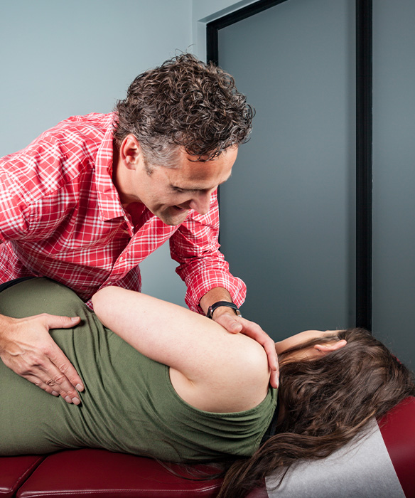 chiropractor giving woman side adjustment
