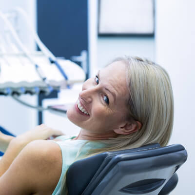 Smiling woman in dentist chair