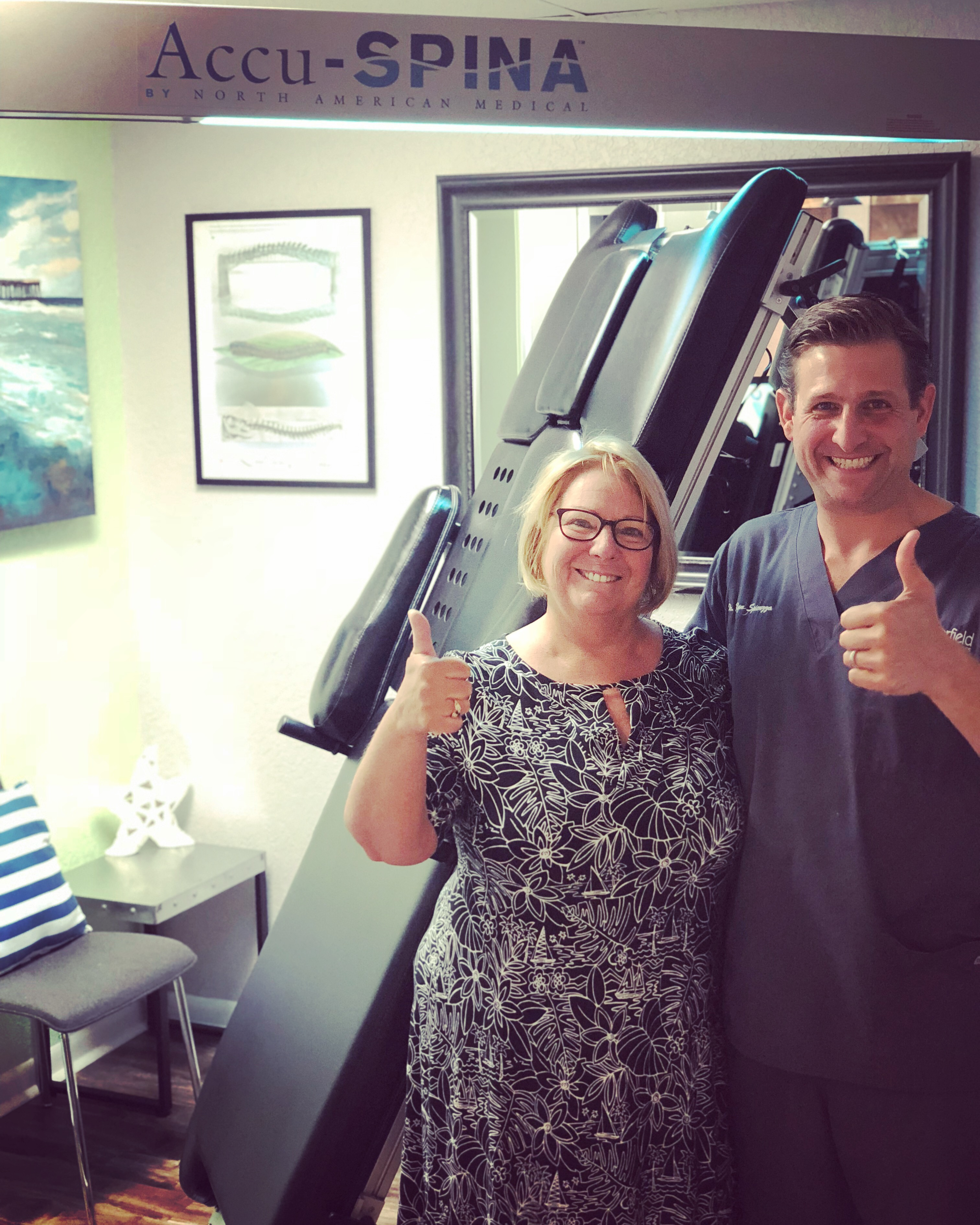 Chiropractic Doctor and Patient giving thumbs up
