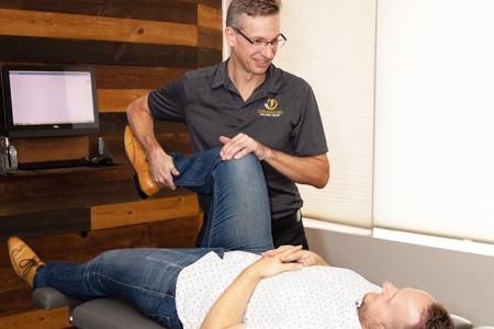 Dr Cox testing patient's flexibility
