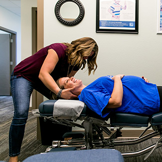 Pregnancy patient being adjusted by a chiropractor