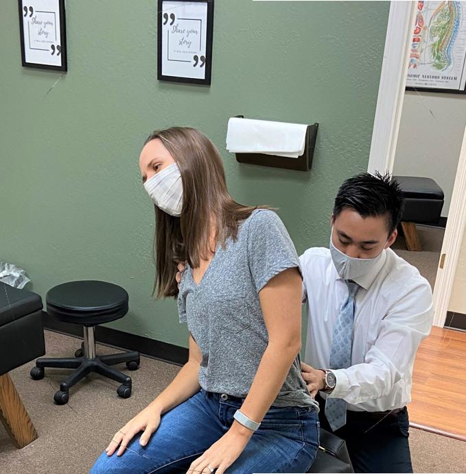Dr. Sullivan examining patient