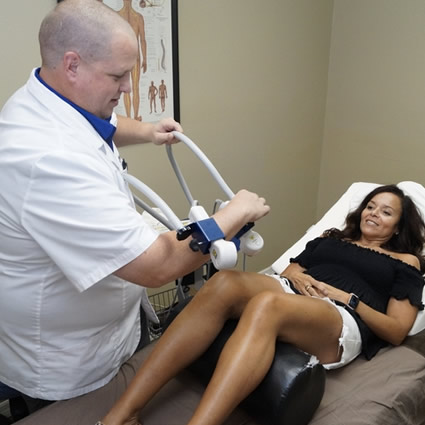 Doctor using cold laser therapy on patient