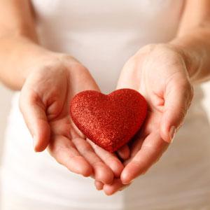 woman-holding-heart-sq-300