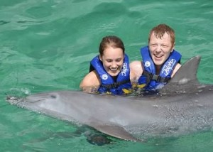 Couple swimming with dolphin