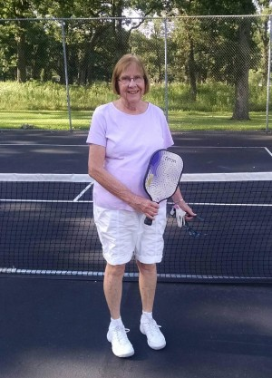 Leila with tennis racquet