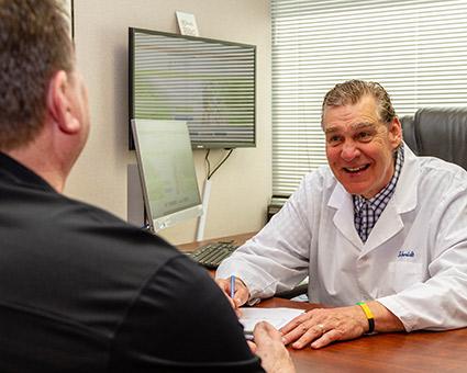 Dr Schmidt talking to patient