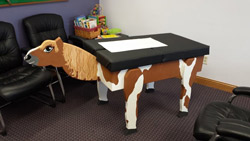 Our new kid's adjusting table! The kids named her Ginger!