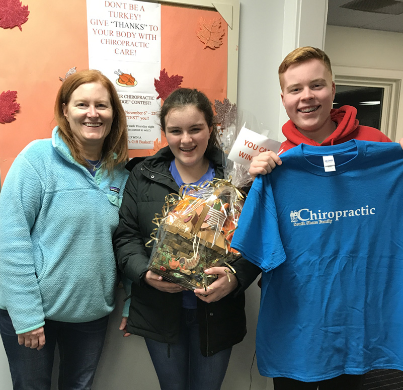 Patients holding gift basket and t-shirt