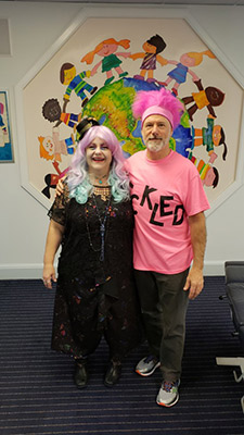Dr. Bill and woman dressed up