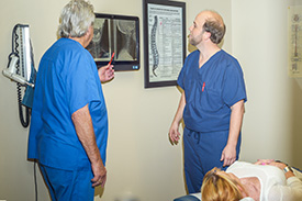 Dr. Larry Cole and Dr. Josh Cole review X-rays.