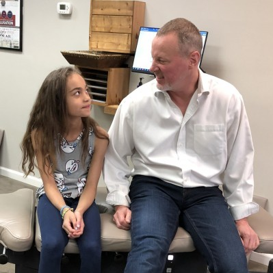 Doctor with a child chiropractic patient