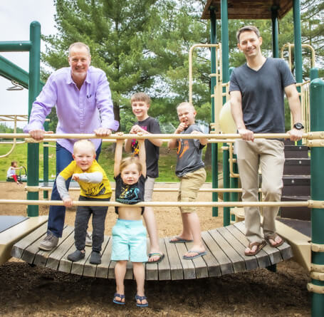 Dr. Scott with patients on jungle gym