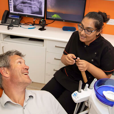 Oral Health Therapist chatting with male patient
