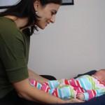 Dr. Laura adjusting a newborn
