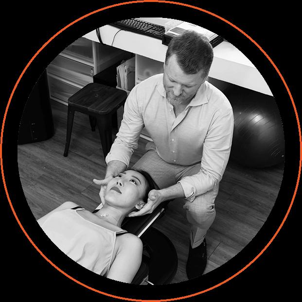 Dr. Fisher adjusting neck