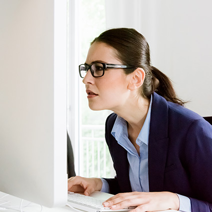 woman slouching at computer desk