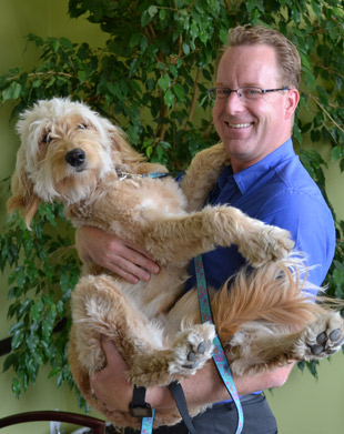 West Kelowna Chiropractor Dr. Kevin with therapy dog.