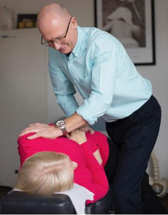 Dr Luke manula adjusting woman
