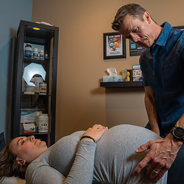 Dr. Mark with pregnant patient