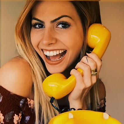 WOman on yellow telephone